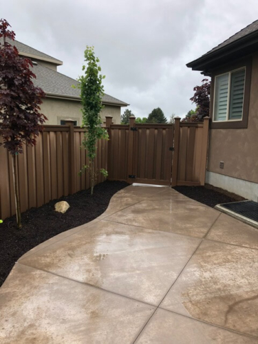 Colored Concrete and Trex Fencing