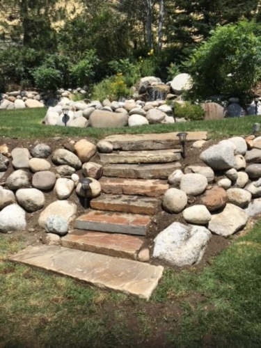 Stone steps installed into existing rock wall