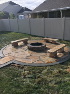 Flagstone Patio with Fire Pit and Stone Benches
